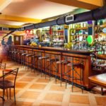 18184483 - interior of a modern pub in orange and wooden colors.