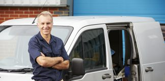 working tradesman with van