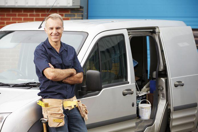working tradesman with van