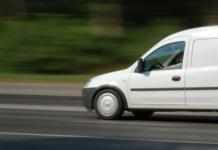 1478707 - white van moving fast at main street.