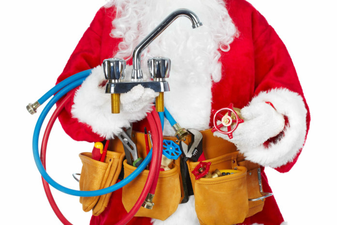 Santa Claus dressed as a plumber