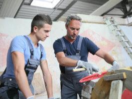 Tradesman teaches young apprentice