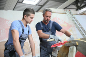 Tradesman teaches young apprentice