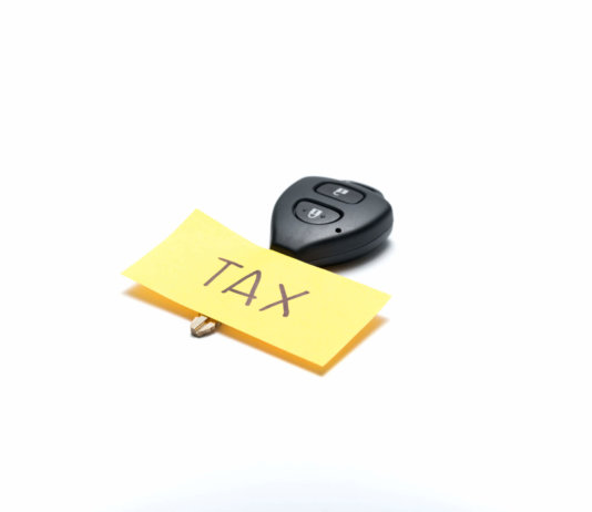 Photo of a key with a handwritten post-it note with TAX written on it to warn of the new changes to tax coming in April 2017.