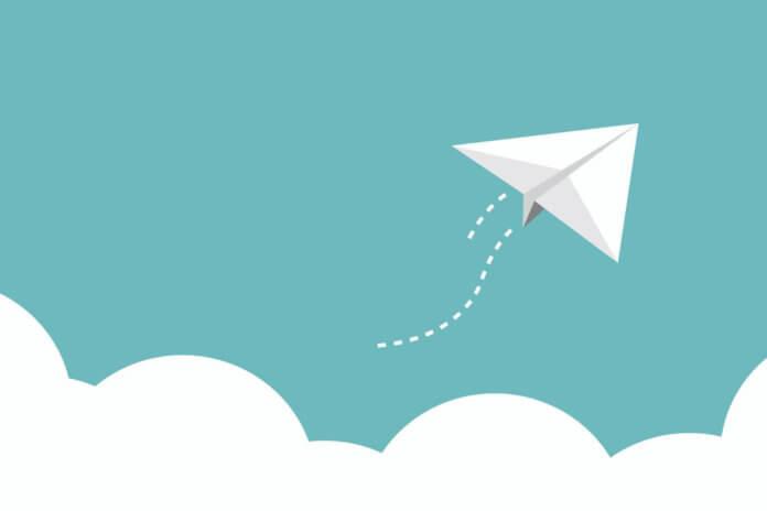Paper plane flying high